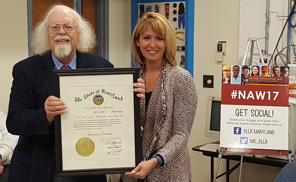 Maryland Labor Secretary Kelly Schulz presented John Taylor with the Governor's Citation
